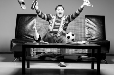 bigstock-soccer-fan-is-sitting-on-sofa--47133304
